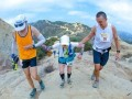 Two 50k runners help 82 year old Patricia Devita.